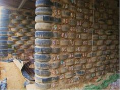 """The recycled house design called """"earthship"""" is a """"green project"""" and designed by biotecture in Taos, New Mexico, United States. Materials that used in this construction are used car tires, empty plas (Bottle Garden Wall)"""