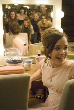 Ellen Page. Keepin it classy. Classy hair do, classy dress.