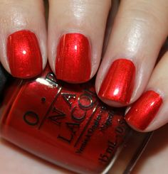 OPI - The Spy Who Loved Me is a bright apple red with gold glitter bits.