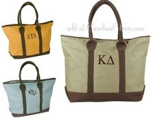 """These Weekender Travel Tote Bags look like fall in the mountains! Or a weekend at the cottage! Carry that sophisticated, relaxed attitude with you whenever you need a roomy weedender tote. Rolled for comfort, handles are the right length for shoulders and the waterproof fabric are just the right details for fashion and function. 14"""" x 21"""" Available in olive green, blue and pumpkin orange."""