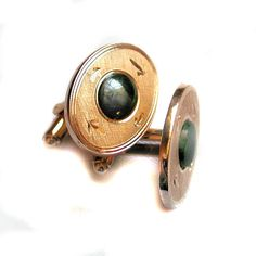 These are high quality 1960s vintage cufflinks with real dark green jade gemstone cabochons set in broad oval etched gold tone frames. Each has 4