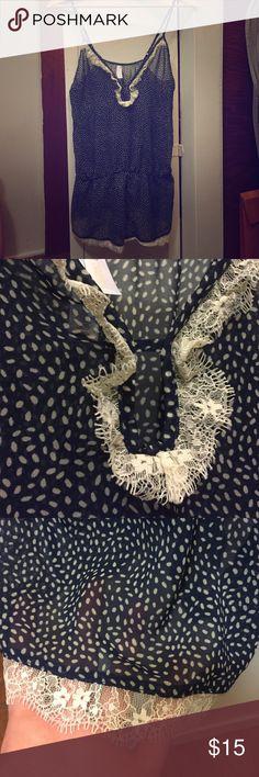 Sheer strappy romper with keyhole neckline Sheer polka dot romper, sweet keyhole neckline, elastic waist, lace trim. Like new. Gilligan & O'Malley Intimates & Sleepwear