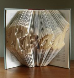 Turning old books into art by folding the pages into words [5 pictures]...