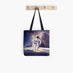 This astronaut in space design makes a beautiful tote , sure to get attention Latest Handbags, Purses And Handbags, Handbags Michael Kors, Louis Vuitton Handbags, Ysl Crossbody Bag, Cluch Bag, Yves Saint Laurent Bags, Designer Leather Handbags, Astronaut