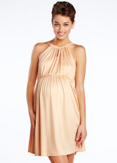 Peach perfection. Adorably elegant dress.