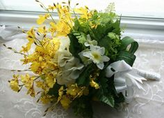 Yellow Oncidium Orchids, White Hydrangea, White/Yellow Narcissus, Several Varieties Of Greenery & Foliage Wedding Bouquet