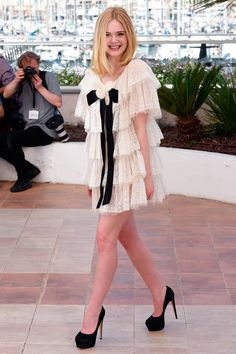 19 May Elle Fanning made a statement in a tiered, white Chanel mini-dress and black heels at the photo call for The Neon Demon.   - HarpersBAZAAR.co.uk