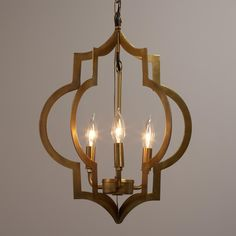 Our Moroccan-inspired pendant is designed for use with three candelabra bulbs and features two quatrefoil symbols finished in elegant antique gold. >> #WorldMarket Home Decor, Lighting
