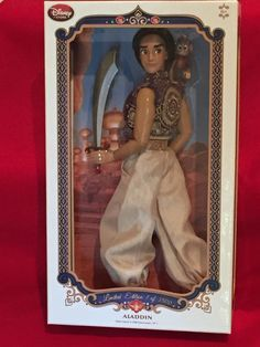 """Disney's Aladdin Limited Edition 17"""" Doll - Limited Edition 1 of 3500 - Includes Certificate of Authenticity - Fully poseable - Display stand included - Comes in elegant window display case - Celebrat"""