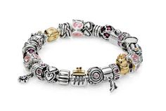 A true 'girlie' bracelet with handbags, stilettos and shades of pink - we love it!