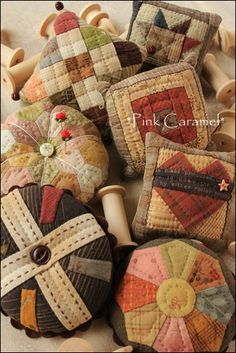 Assorted quilted pincushions