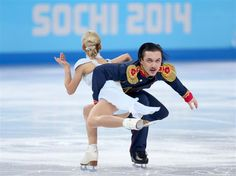 DAY 5:  Tatiana Volosozhar and Maxim Trankov of Russia compete during the Figure Skating Pairs Short Program