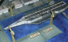 CVN Concept - Future Stealth Carrier Paper Model - by Paper Hobby - == -  A Stealth Carrier for the future, in 1/800 scale, complete, with all the details you see in the picture. Created by Indonesian designer Tekzo, from Paper Hobby website.
