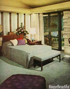 bedroom with windowed door onto patio. At night, the bedroom becomes mysteriously beautiful, suffused with glowing light from sources concealed in the surrounding deck that may be dimmed or intensified in endless ways, combined almost like musical chords, to fit the occupant's need or mood. The bed wall is luminous enchantment in itself. Featured in the February 1960 issue House Beautiful