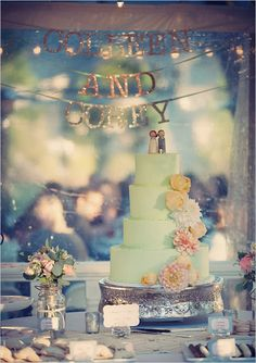 i like the stringed names behind the cake table.