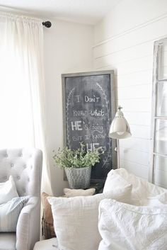 farmhouse living room with large chalk board.