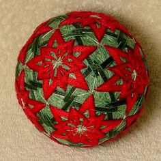 Temari means Handball. A Highly valued gift symbolizing deep friendship and loyalty. Brightly colored threads with the Recipient a Brilliant and Happy Life  Temari is an ancient form of Japanese culture and art, the gift or a Temari ball is believed to bring good fortune to the recipient. This Temari ball is a styroforam ball wrapped with yarn and thread and sewn with contemporary and traditional patterns. 3 1/4 inch diameter  This ball is made by me, Beth