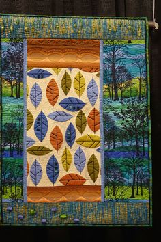 In A Cool Blue Forest by Heidi Zielinski. Photo by Sew Fun 2 Quilt. 2014 Denver Quilt show