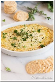 Baked Herb & Garlic Goat Cheese Dip - Fresh herbs and garlic are blended with a goat and cream cheese mixture and baked to perfection. The result is a warm and creamy dip perfect for entertaining!