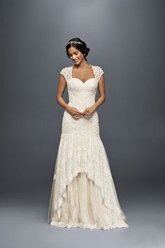 A beautiful lace wedding dress with cap sleeves by Melissa Sweet. Over 3,000 beads on the bodice, with a dreamy lace and tulle skirt. Exclusively at David's Bridal.