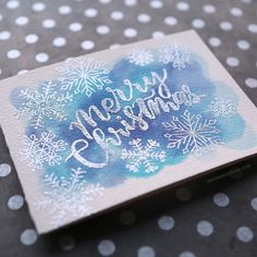 Chipped Sapphire, Broken China and Tumbled Glass Distress ink. Ranger Super Fine Detail Silver EP.  I stamped the snowflakes from the Christmas Cheer stamp set from Avery Elle and Simon Says Stamp (it is one of the Stamptember exclusive stamp sets) in VersaMark ink and added more silver embossing powder.