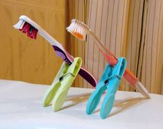 Easy travel idea to keep toothbrush off counter yet allow to dry between uses.  Couple clothespins in kit won't take much space.