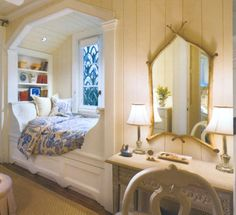 love the arch way on the top of this one, and the built in bookcase above the headboard.