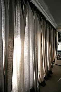 This is a great idea. The fabric might be expensive. Even if there weren't a lot of windows on the wall you could still hang some sort of lighting behind it to get a similar effect.