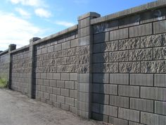 Image from http://www.camstags.com/wp-content/uploads/2015/02/modern-grey-cement-block-fence-wall-that-can-add-the-natural-nuance-inside-with-high-building-make-it-seems-modern-nuance-by-applying-cement-as-the-materials-inside-the-house-design.jpg.