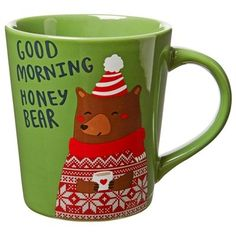 """Our bright holiday mug is generously sized and has a gently tapered shape that feels good in your hand, just like a warm hug. An affectionate bear sporting a Fair Isle sweater is always ready to offer up some love. 16-oz./473ml capacity. 4"""" diameter, 4.5"""" tall. Stoneware. Dishwasher- and microwave-safe. Available only at Indigo."""