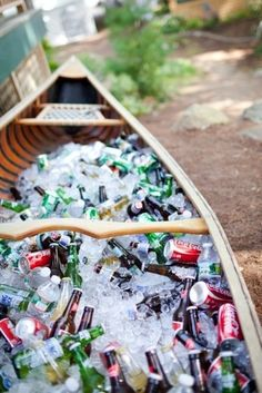 Canoe as a huge cooler. (idea of a flower bed too...)  I would love to promise my canoe that I will never do this to her, buuuut.... That's a pretty awesome idea!!!