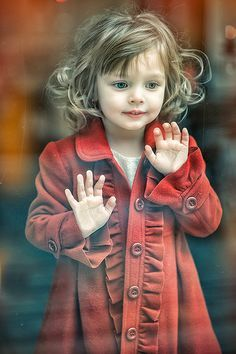Little one in a long red coat
