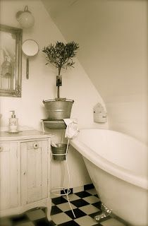 Cottage bath... Cheap floor. Doesn't look too bad.