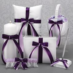 Custom Ribbons Collection - White  White collection accented with choice of two colors of satin bows. This 6 piece collection includes flower basket, ring pillow, guest book and pen, unity candle, and garter