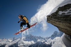 High-Res Stock Photography: snowboarder jumps off a rock at Le…