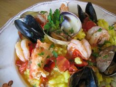 Rustic Bowl of Italian Seafood Risotto with Shrimp, Mussels, Clams and Saffron