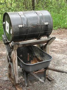 This is pure genius, and simplicity defined. Whoever thought up a lifted barrel compost tumbler to fit a wheelbarrow under to dump the finished product in was definitely thinking about convenience during the blueprint stage.