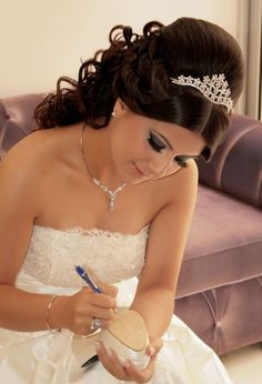 Wedding Hairstyle with Tiara Hate this style, it would be terrible on me.