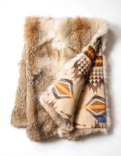 The most fabulous throw ever! 100% natural coyote backed with a genuine Pendleton blanket. In-stock now at www.antekshome.com