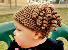 Little Miss Curly Q Beanie, pattern by Loop Leigh Loops. I made one for my great-niece. Love this pattern!