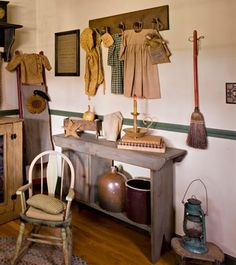 Open and Clothes: Reproduction clothing provides textile style in this wall display in the guest bedroom of Sue and Ted Bucks\