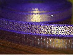 "Beautiful Purple Color hand-loom border from India, Jacquard ribbon border trim. Trim is decorated with golden metallic thread embroidery.   ➤ This listing is sold by (8 yard) Width: 0.5 ""..."