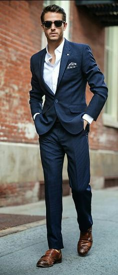 Navy suit, monk strap shoes, and a great pair of glasses help this look come together!