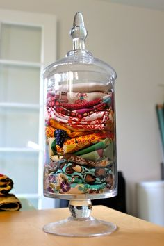 Use an apothecary jar to store scarves