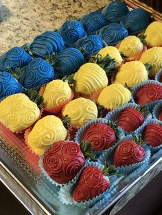 Blue, yellow & red chocolate covered strawberries