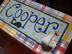 custom painted whole name canvas  - painted to match Pottery Barn Kids madras plaid. $36.00, via Etsy.
