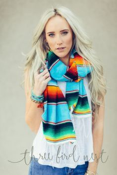 Wrap yourself up in a colorful snap of color with our woven Mexican Sarape Blanket Scarf Wrap with fringe ends. Endless compliments will abound when you're wearing a timeless piece paired with jean sh