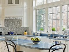 Brazilian Blue Stone - High-End Kitchen Countertop Choices on HGTV Brazilian Blue Stone In the course of adding a two-story addition to a landmarked Brooklyn townhouse, architect Ben Herzog, working in conjunction with interior designer Elizabeth Cooke-King, added a large, light-filled kitchen to the home. As a fitting focal point for this dramatic space, the design team chose beautiful Azul Macauba, a blue stone from Brazil, to top the Shaker-style white cabinets.