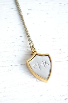 Monogram crest pendant necklace by White Truffle