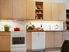 Wood Kitchen Cabinets with White Appliances White Appliances Birch Cabinets Apartment Therapy TtvQfdTE Birch Kitchen Cabinets, Light Wood Cabinets, Maple Cabinets, Plywood Kitchen, Brown Cabinets, Kitchen Wood, White Kitchen Appliances, Kitchen White, Condo